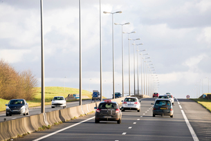 郊外を走るフランス高速道路の写真素材 [FYI02838526]