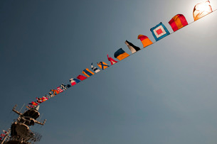 Flags fly over the deck of the USS Iwo Jima.の写真素材 [FYI02851270]