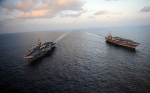 Nimitz-class aircraft carriers transit the Arabian Sea.の写真素材 [FYI02851597]