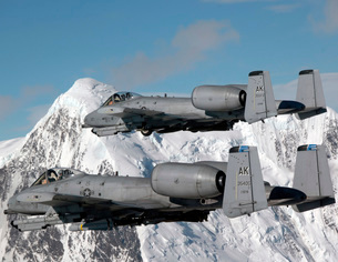 A-10 Thunderbolt II's fly over mountainous landscape.の写真素材 [FYI02851617]