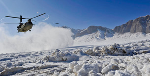 Snow flies up as a U.S. Army CH-47 Chinook prepares to land.の写真素材 [FYI02851629]