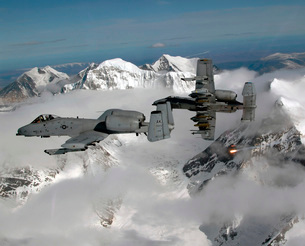 A-10 Thunderbolt II's fly over mountainous landscape.の写真素材 [FYI02851644]
