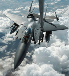 An F-15 E Strike Eagle receives fuel from a KC-10 Extender.の写真素材 [FYI02851686]