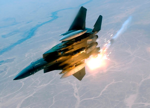 An F-15E Strike Eagle pops flares during a combat sortie.の写真素材 [FYI02851693]