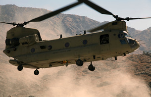 A CH-47 Chinook helicopter kicks up dust as it lands in Afghanistan.の写真素材 [FYI02851748]
