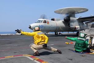 Sailors launch an E-2C Hawkeye aboard USS Dwight D. Eisenhower.の写真素材 [FYI02851753]