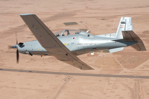 A T-6 Texan flying over Camp Speicher, Tikrit, Iraq.の写真素材 [FYI02851818]