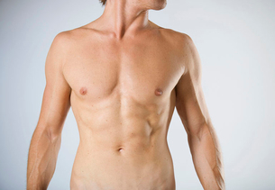 A male nude, mid sectionの写真素材 [FYI02852807]