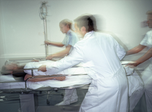 Emergency medical staff bringing in patient on stretcher, blurredの写真素材 [FYI02852946]