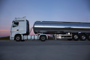 Stainless steel milk tanker on the road at nightの写真素材 [FYI02853109]