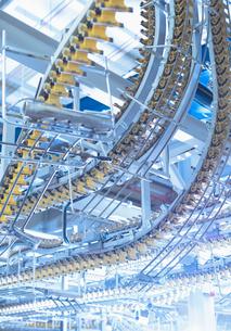 Winding printing press conveyor belts overheadの写真素材 [FYI02853737]