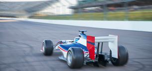 Formula one race car on sports trackの写真素材 [FYI02853890]