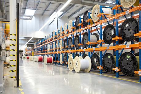 Large spools on racks in fiber optics factoryの写真素材 [FYI02853954]