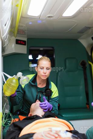 Sweden, Sodermanland, Tumba, Paramedics taking care of patientの写真素材 [FYI02854304]