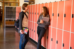 Sweden, Stockholm, Ostermalm, Students talking on school corridorの写真素材 [FYI02854765]