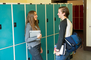 Sweden, Stockholm, Ostermalm, Students talking on school corridorの写真素材 [FYI02854776]