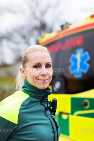 Sweden, Sodermanland, Tumba, Paramedic next to ambulanceの写真素材 [FYI02855007]