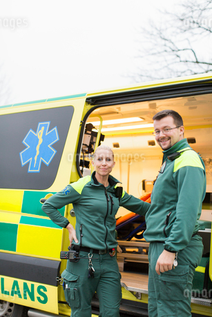 Sweden, Sodermanland, Tumba, Two paramedics next to ambulanceの写真素材 [FYI02855264]
