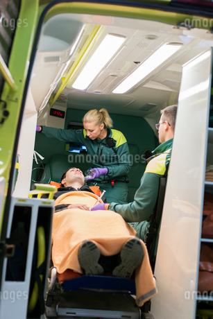 Sweden, Sodermanland, Tumba, Paramedics taking care of patientの写真素材 [FYI02855287]