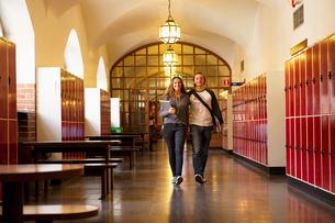 Sweden, Stockholm, Ostermalm, Students walking on school corridorの写真素材 [FYI02855313]