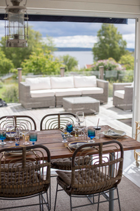 Sweden, Halland, Onsala, Dining room with terraceの写真素材 [FYI02855321]
