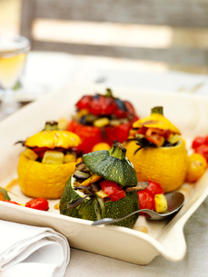 Sweden, Vastergotland, Stuffed, baked peppers and squashの写真素材 [FYI02855329]