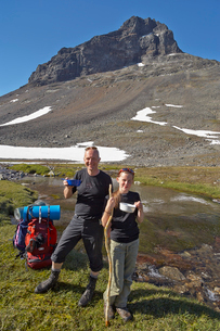 Sweden, Sarek National park, Pastavagge, Father and daughter (12-13 years) hiking in mountainsの写真素材 [FYI02855437]