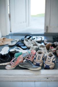 Sweden, Gotland, Shoes in hallwayの写真素材 [FYI02855540]