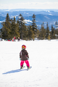 Norway, Osterdalen, Trysil, Girl (4-5) learning how to skiの写真素材 [FYI02855564]