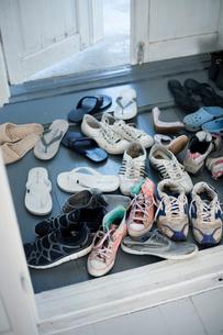 Sweden, Gotland, Shoes in hallwayの写真素材 [FYI02855629]