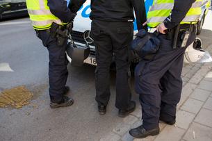 Sweden, Smaland, Jonkoping, Policemen arresting participant of demonstrationの写真素材 [FYI02855634]