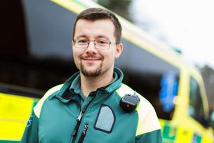 Sweden, Sodermanland, Tumba, Paramedic next to ambulanceの写真素材 [FYI02855645]