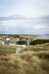 Sweden, Skane, Skanor, Small wooden huts on coastの写真素材 [FYI02855673]
