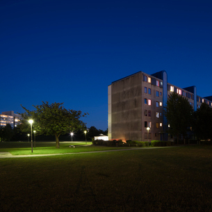 Sweden, Skane, Malmo, Rosengard, Park in residential district at nightの写真素材 [FYI02855736]