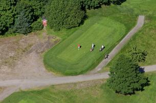 Finland, Uusimaa, Siuntio, Three men playing golfの写真素材 [FYI02855742]