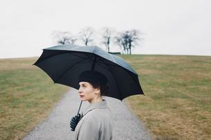 Sweden, Sodermanland, Stockholm, Skogskyrkogarden, Portrait of woman at Woodland Cemeteryの写真素材 [FYI02855743]