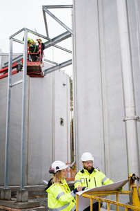 Sweden, Vastmanland, Four people working at water treatment plantの写真素材 [FYI02855796]