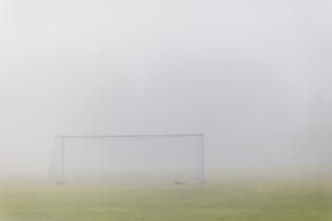 Sweden, Vastmanland, Soccer field covered in fogの写真素材 [FYI02855810]