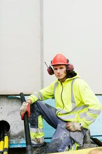 Sweden, Vastmanland, Portrait of construction worker holding pipeの写真素材 [FYI02855819]