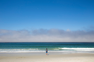 USA, California, Carmel-by-the-Sea, California, USA, Boy (14-15) standing on beachの写真素材 [FYI02856069]