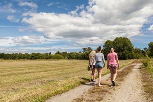 Sweden, Blekinge, Solvesbor, Torso, Teenage girls (14-15) walking in countrysideの写真素材 [FYI02856189]