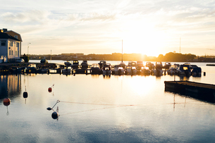 Boats at the marina at sunset in Karlskrona, Swedenの写真素材 [FYI02856199]