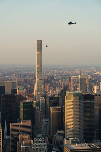 Cityscape of New York City with helicopterの写真素材 [FYI02856204]
