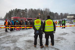 Sweden, Uppland, Upplands Vasby, Rescue workers of Missing people organization looking at crowdの写真素材 [FYI02856297]