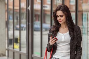 Woman looking at a smart phone in Blekinge, Swedenの写真素材 [FYI02856303]