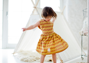 Sweden, Girl (4-5) dancing next to tent at homeの写真素材 [FYI02856311]