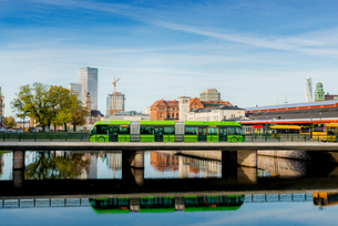 Sweden, Oresund Region, Skane, Malmo, City bus on bridge by Central Stationの写真素材 [FYI02856667]