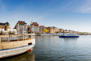Sweden, Stockholm, Nybroviken, Tourboat leaving harborの写真素材 [FYI02856739]
