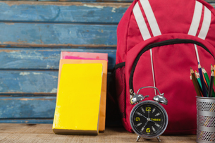 Bagpack, books, alarm clock and pen holderの写真素材 [FYI02856756]