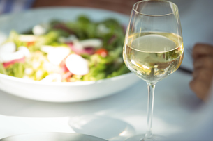 Close-up of food and wine glass on dining tableの写真素材 [FYI02856839]